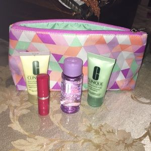 A set of beauty products with a makeup pouch